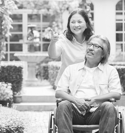 caregiver assisting senior man outdoor