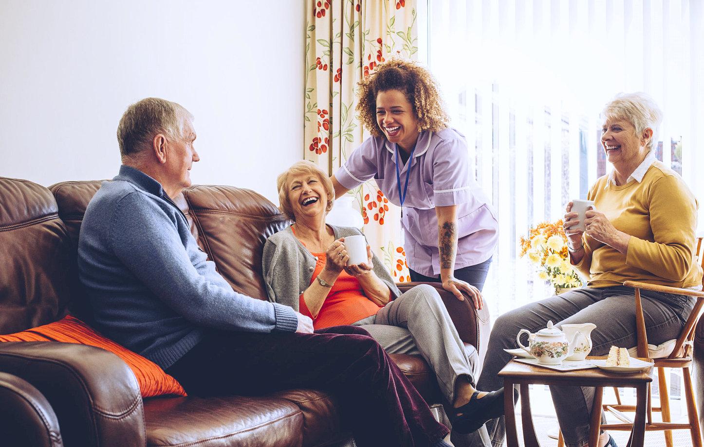 caregiver assisting a group of senior