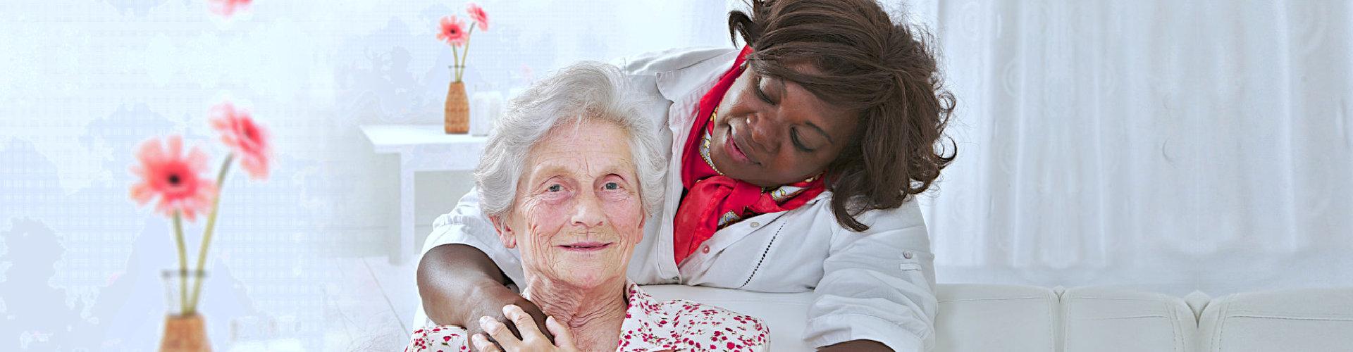 caregiver looking at the senior woman